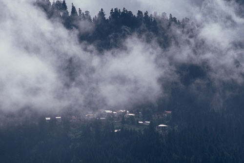 Moving clouds over a mountain village (Canon EOS 650 with 100-300mm zoom lens set at 300mm, Velvia ISO 50 slides film)