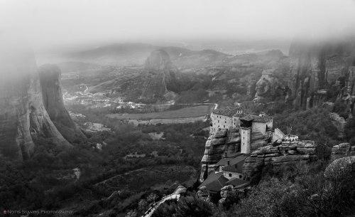 Rousanou monastery and St. Nikolaos monastery in the morning fog.